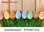 easter eggs in green grass on a ... | Shutterstock . vector #574447141