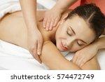massaging the stress away.... | Shutterstock . vector #574472749