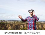 young man in virtual reality ... | Shutterstock . vector #574496794