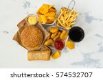 junk food on table. fast... | Shutterstock . vector #574532707