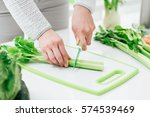 woman preparing food in her... | Shutterstock . vector #574539469