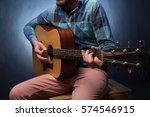 Young Man Playing On Acoustic...
