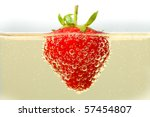 A Fresh Strawberry Floating In...