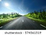 road in forest  sweden | Shutterstock . vector #574561519