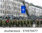 RUKLA, LITHUANIA - FEBRUARY 8, 2017: NATO soldiers stand in line. NATO flag behind the soldiers - stock photo
