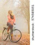 happy active woman riding bike... | Shutterstock . vector #574585051