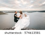 couple with a bouquet and... | Shutterstock . vector #574613581