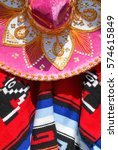 Small photo of Mexico poncho and serape sombrero close up
