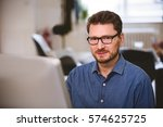 Small photo of Portrait of confident male executive with computer at office