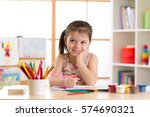 smiling kid drawing with color... | Shutterstock . vector #574690321