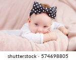 portrait of a beautiful baby... | Shutterstock . vector #574698805
