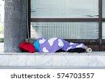 Homeless Barefooted Woman Slee...