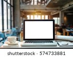 front view of cup and laptop on ...   Shutterstock . vector #574733881