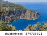 isolated bay in aegean cliffs | Shutterstock . vector #574739821