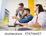 young colleagues discussing... | Shutterstock . vector #574746457