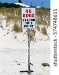 a sign on a beach reads  no... | Shutterstock . vector #574748611