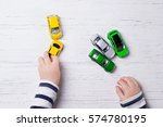 child hands playing with... | Shutterstock . vector #574780195