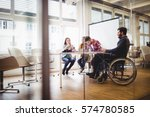 coworker on wheelchair with... | Shutterstock . vector #574780585