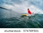 young lady surfer trying to... | Shutterstock . vector #574789501