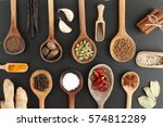 spices in wooden spoon black... | Shutterstock . vector #574812289