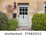 light green wooden doors in an... | Shutterstock . vector #574824211