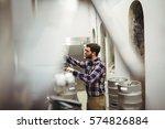 male manufacturer inspecting... | Shutterstock . vector #574826884
