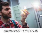 young manufacturer holding beer ... | Shutterstock . vector #574847755