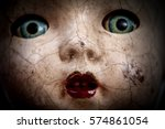 scary cracked old doll face ... | Shutterstock . vector #574861054