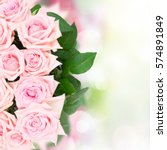 Stock photo pink blooming rose flowers and leaves border over garden bokeh background 574891849