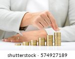 female hand putting money coin... | Shutterstock . vector #574927189