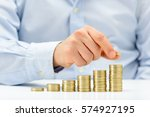 male hand putting money coin... | Shutterstock . vector #574927195