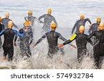 triathlon competitors in swim... | Shutterstock . vector #574932784