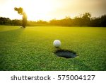 Golfer Putting Golf Ball On Th...