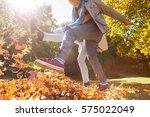 Friends Kicking Autumn Leaves...