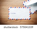 Small photo of air mail envelope on the wood table