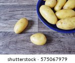 Fresh Potatoes In Blue Dish