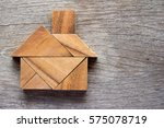 wooden tangram puzzle in home... | Shutterstock . vector #575078719