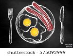 scrambled eggs with bacon on a... | Shutterstock .eps vector #575092999