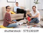 three young designers... | Shutterstock . vector #575130109