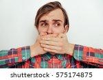 man closes a mouth hands | Shutterstock . vector #575174875