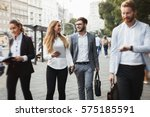 business colleagues walking and ... | Shutterstock . vector #575185591