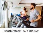 people running on treadmill in... | Shutterstock . vector #575185669
