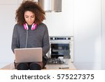 attractive young woman typing... | Shutterstock . vector #575227375