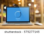 laptop on table with importing... | Shutterstock . vector #575277145