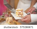 wedding cake is divided into... | Shutterstock . vector #575280871