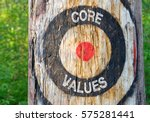 Small photo of Core Values - tree with target and text in the forest