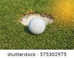 golf ball on lip of cup on... | Shutterstock . vector #575302975