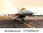 Small photo of military fighter jet aircraft parked in the airforce on sunset