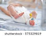 newborn baby boy covered in... | Shutterstock . vector #575329819