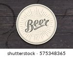 coaster for beer with hand... | Shutterstock .eps vector #575348365